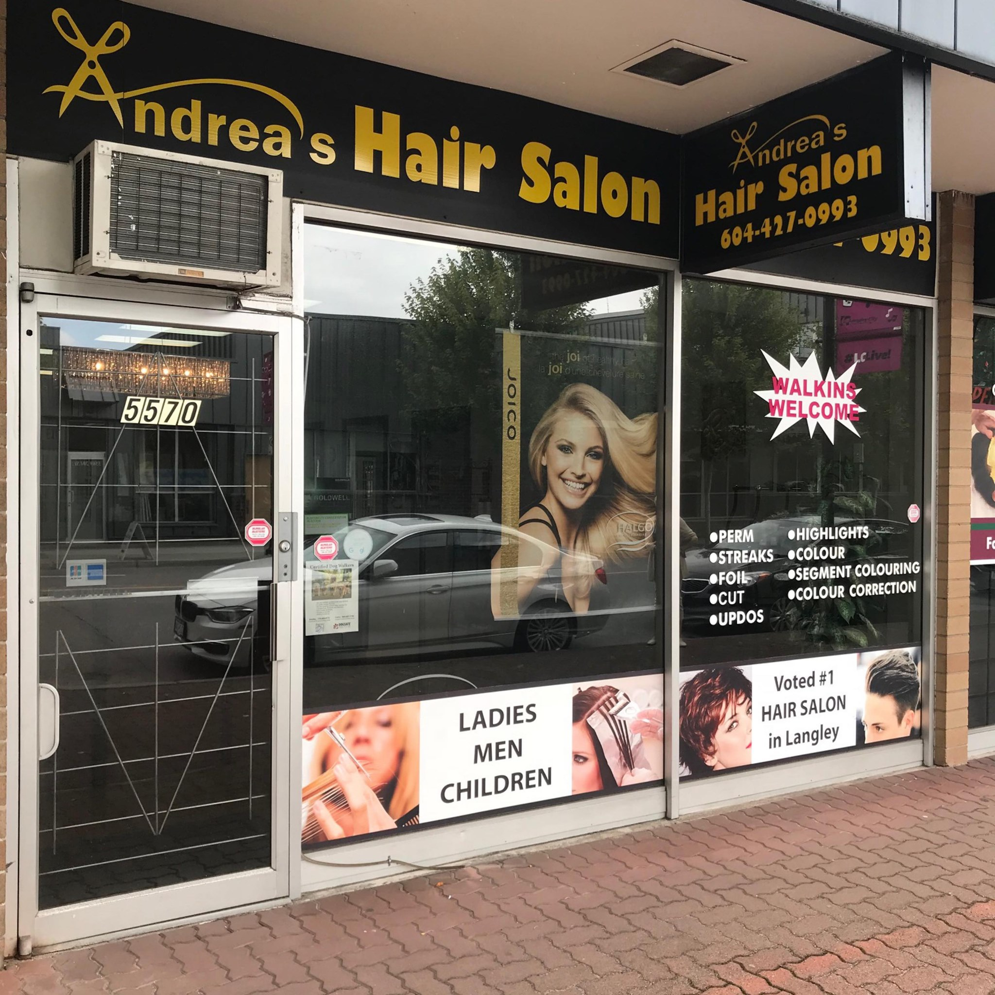 Andrea's Hair Salon logo
